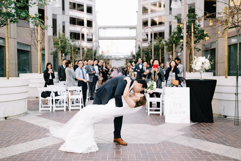 kiss with guests in the back for amazing ceremony recessional photos